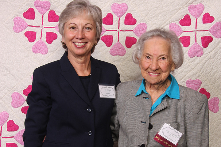 dr-wynd-and-dorothy-gorenflo-cluff-42-with-the-quilt-dorothy-designed-and-made-to-raise-funds-for-student-scholarships